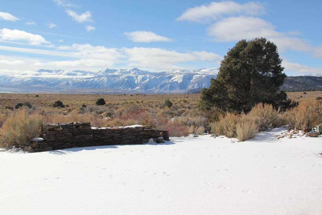 stone wall, sagebrush and mountains